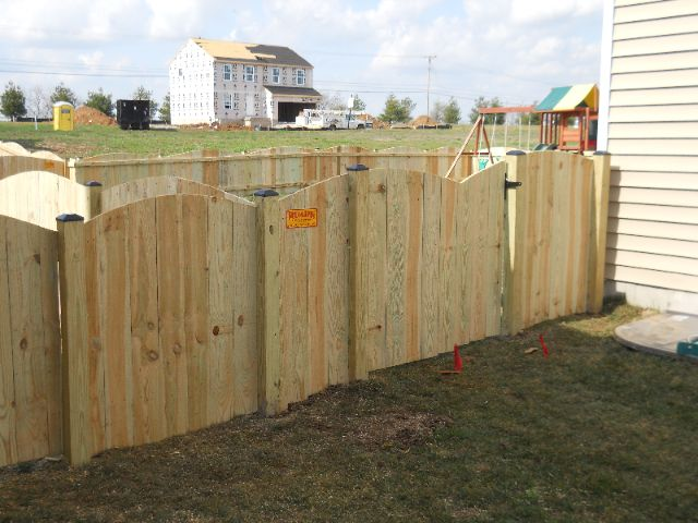 Georgetown Scoop style wood privacy fence